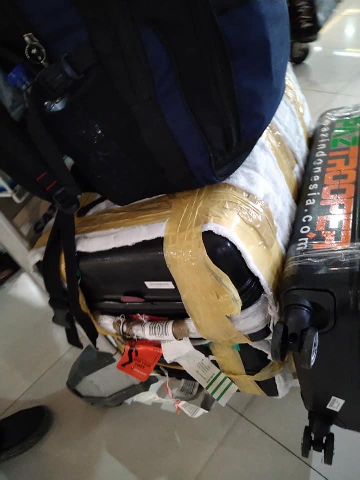 tips packing baju umroh koper laki laki